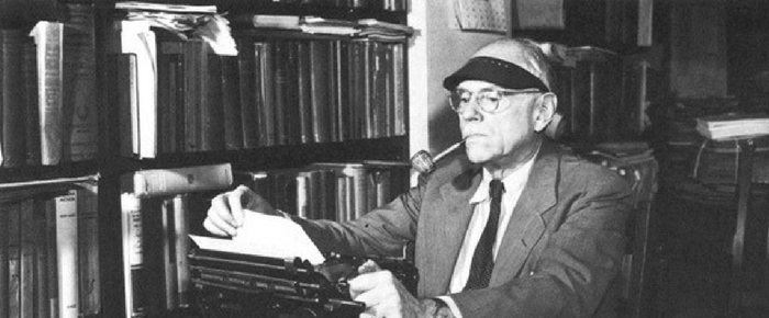Frank Knight typing at his desk