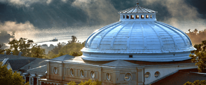 The Bailey Hall Dome with Cayuga Lake in the distance