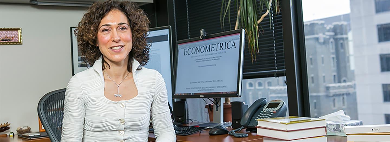 Francesca Molinari sitting at her desk